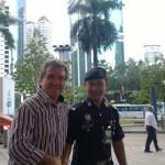 Maláj rendőrök a turistákért